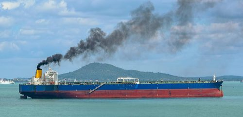 A tanker belching greenhouse gases and black soot particulates into the atmosphere.