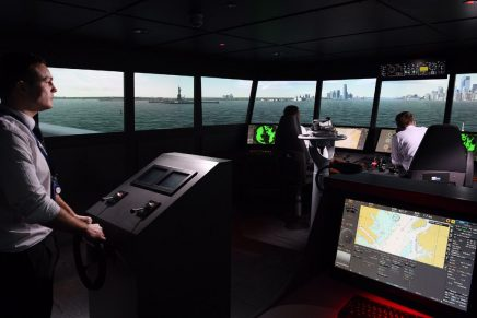 Trainees in a modern Main Bridge Simulator, practising an approach to New York Harbour in a large vessel.