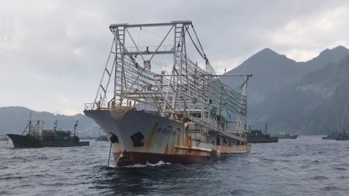 Together with other vessels of the Chinese fishing fleet in the harbour at Ulleung Island, a ship fitted with a big gantry of lights for attracting squid to the surface